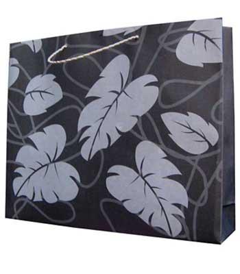 taskertas motif daun hitam putih